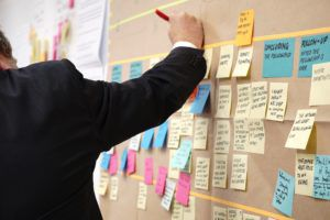 Man at wall filled with sticky notes
