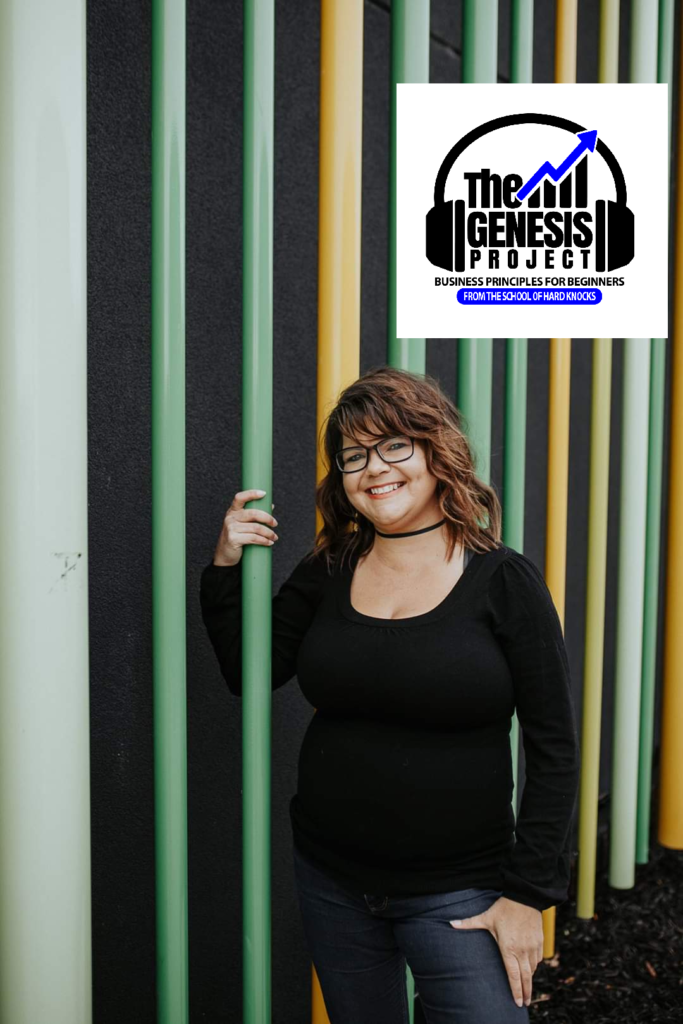 Michelle Virog standing next to a multi colored, vertical striped wall