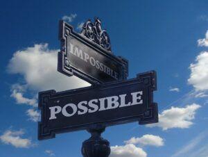 """Street signs that says """"Impossible"""" and """"Possible"""""""